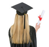 Woman in graduation gown with diploma . rear view — Stock Photo