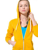 Portrait of serious teenager girl in sweater with draped hood — Stockfoto