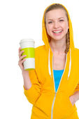 Portrait of happy teenager girl holding coffee cup — Stock Photo