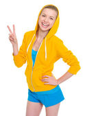 Happy teenager girl showing victory gesture — Stock Photo