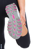 Closeup on sole of stretching fitness woman — Stock Photo