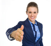 Happy business woman stretching hand for handshake — Stock Photo