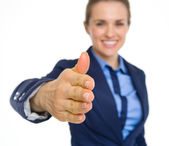 Closeup on happy business woman stretching hand for handshake — Stock Photo