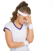 Portrait of concerned female tennis player — Stock Photo