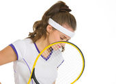 Thoughtful female tennis player holding racket — Stock Photo