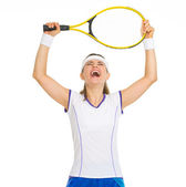 Happy female tennis player with racket rejoicing success — Stock Photo