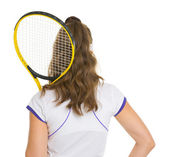 Female tennis player with racket . rear view — Stock Photo