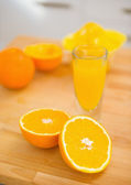 Closeup on cutted orange on cutting board — Stockfoto