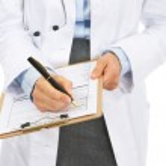 Closeup on doctor woman writing in clipboard — Stock Photo