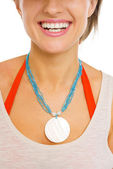 Closeup on necklace on neck of young beach woman — Stock Photo
