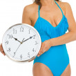 Closeup on woman in swimsuit showing clock — Stock fotografie