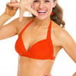 Portrait of happy young woman in swimsuit with starfish — Stock Photo