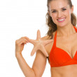 Smiling young woman in swimsuit with starfish — Stock Photo