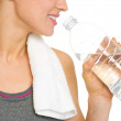 Closeup on young woman drinking water — Stock Photo
