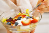Closeup on fruits salad in hand of woman — Foto de Stock