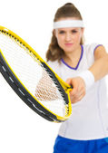 Closeup on racket in hand of tennis player — Photo