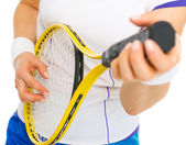 Closeup on female tennis player playing on racket as on guitar — Stock Photo