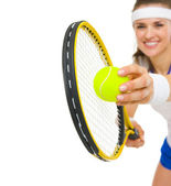 Closeup on female tennis player serving ball — Stock Photo