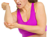 Closeup on woman with elbow pain — Stock Photo