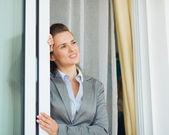Dreamy business woman near window — Stock Photo