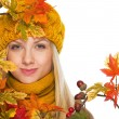 Young woman in hat and scarf with autumn bouquet — Stock Photo