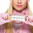 Closeup on pills pack in hand of teenager girl in winter gloves — Stock Photo #30044511