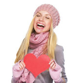 Happy teenager girl in winter hat and scarf with heart shaped po — Stockfoto