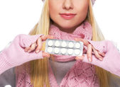 Closeup on pills pack in hand of teenager girl in winter gloves — Zdjęcie stockowe