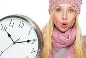 Portrait of surprised teenager girl in winter hat and scarf with — Stock Photo
