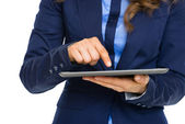 Closeup on business woman working on tablet pc — Stock Photo