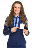 Smiling business woman pointing on badge — Stock Photo