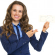 Smiling business woman pointing on air tickets — Stock Photo #30050395