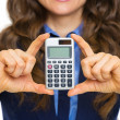 Closeup on calculator in hand of business woman — Stock Photo
