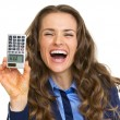 Smiling business woman showing calculator with hello inscription — Stock Photo