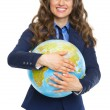 Stock Photo: Smiling business woman hugging earth globe