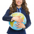 Smiling business woman hugging earth globe — Stock Photo