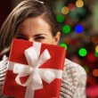 Happy young woman holding christmas present box — Stock Photo #30051251