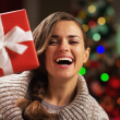 Happy young woman looking out from present box — Stock Photo