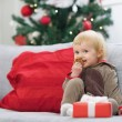 Happy baby in christmas costume eating cookie — Stock Photo #30058769