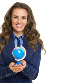 Smiling business woman holding earth globe — Stock Photo