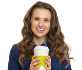 Portrait of smiling business woman with cup of hot beverage — ストック写真