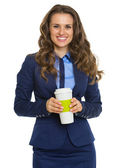 Smiling business woman with cup of hot beverage — Stock Photo