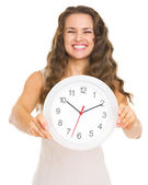 Closeup on clock in hand of smiling young woman — Stock Photo