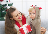 Happy mother and baby spending christmas time together — Stock Photo