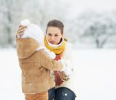 Mother and baby in winter park — Stock Photo