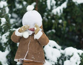 Portrait of happy baby with hat over eyes in winter park — Stock Photo