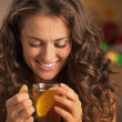 Happy young womenjoying drinking ginger tewith lemon — Stock Photo #33775627
