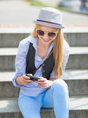 Hipster girl with cell phone — Fotografia Stock
