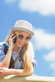 Hipster girl with cell phone — Stock Photo