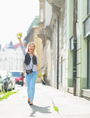 Hipster girl on city street — Stock Photo